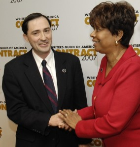 Patric M. Verrone shakes hands with NAACP Image Awards Committee Chair Clayola Brown after a news conference in Los Angeles